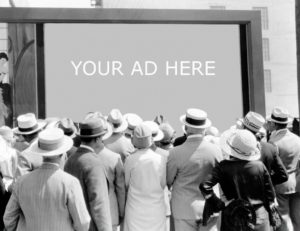 old photo with people looking at an ad