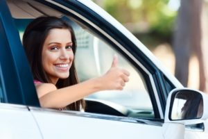 woman giving thumbs up in the car