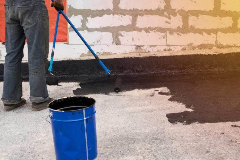 man coating the floor