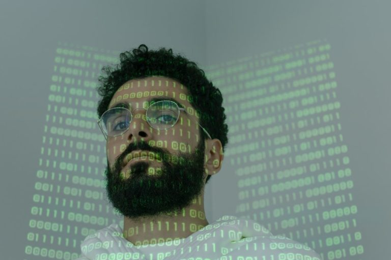 person with codes projected on his face